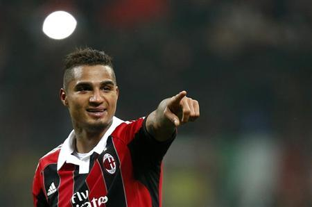 AC Milan's Kevin-Prince Boateng reacts at the end of the team's Champions League soccer match against Barcelona at the San Siro stadium in Milan February 20, 2013. REUTERS/Tony Gentile