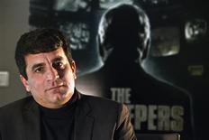 Israeli director Dror Moreh sits for a portrait in Tel Aviv February 14, 2013. REUTERS/Nir Elias