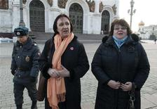 Police escort university professors Yelena Volkova (C) and Irina Karatsuba (R) after detaining them inside the Christ the Saviour Cathedral in Moscow February 21, 2013. REUTERS/Anton Stekov