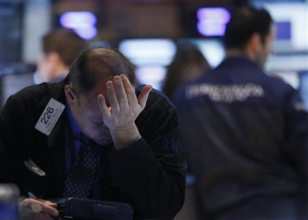 A trader works on the floor of the New York Stock Exchange February 21, 2013. REUTERS/Brendan McDermid