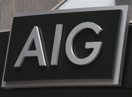 A new sign is displayed over the entrance to the AIG headquarters offices in New York's financial district, January 9, 2013. REUTERS/Brendan McDermid/Files