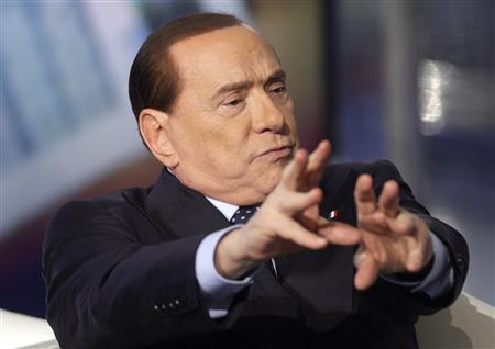 Italy's former Prime Minister Silvio Berlusconi gestures as he appears as a guest on the RAI television show Porta a Porta (Door to Door) in Rome February 20, 2013. REUTERS/Remo Casilli (ITALY - Tags: POLITICS MEDIA) - RTR3E1S8