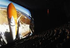 """An audience watches """"The Dream is Alive"""" film at the IMAX Theater at Smithsonian National Air and Space Museum in Washington April 4, 2012. REUTERS/Gary Cameron"""