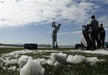 Rafael Cabrera-Bello of Spain warms up on the driving range during the weather delayed first round of the WGC-Accenture Match Play Championship golf tourament in Marana, Arizona, February 21, 2013. REUTERS/Ralph Freso