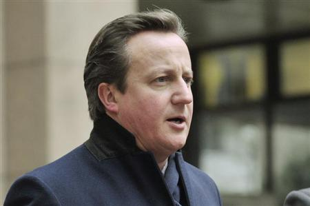 Britain's Prime Minister David Cameron returns after a short break at the EU council headquarters for an European Union leaders summit meeting to discuss the European Union's long-term budget in Brussels February 8, 2013. REUTERS/Eric Vidal