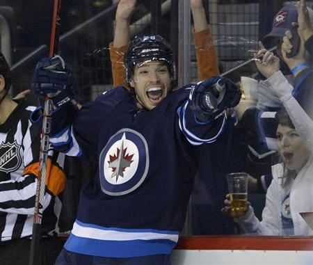 Winnipeg Jets defenseman Redmond sliced by skate in practice