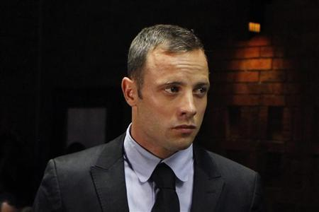 ''Blade Runner'' Oscar Pistorius stands in the dock during a break in court proceedings at the Pretoria Magistrates court February 20, 2013. REUTERS/Siphiwe Sibeko