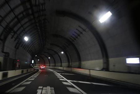 A car drives inside a tunnel of the Metropolitan Expressway in central Tokyo February 15, 2013. REUTERS/Issei Kato