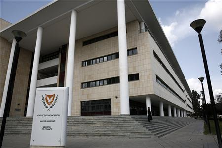A woman leaves Cyprus' finance ministry in Nicosia February 21, 2013. REUTERS/Yorgos Karahalis