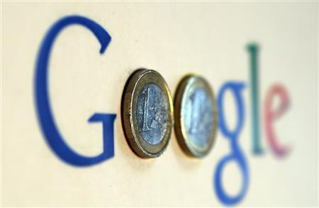An illustration picture shows a Google logo with two one Euro coins, taken in Munich in this January 15, 2013 file photograph. Google Inc shares rose 1 percent to hit $800 per share on February 19, 2013. REUTERS/Michael Dalder/Files
