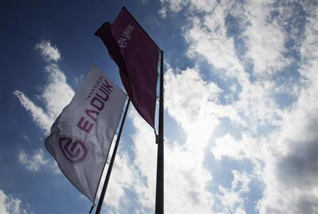 Flags of the German chemical company Evonik Industries flutter in the wind at a factory in Darmstadt June 18, 2012. REUTERS/Alex Domanski