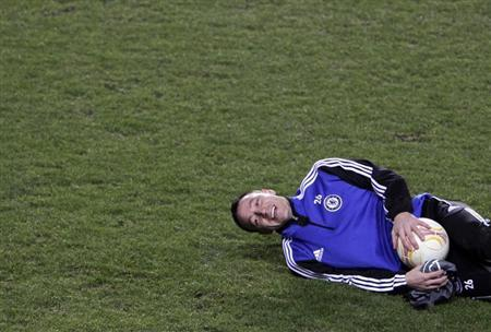 Chelsea's John Terry attends a practice session in Prague February 13, 2013. Chelsea will face Sparta Prague in their Europa League soccer match on Thursday. REUTERS/David W Cerny