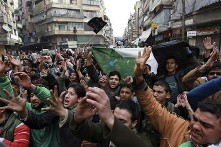 Demonstrators chant slogans and wave Syrian opposition flags during a protest against Syria's President Bashar al-Assad in Bustan al-Qasr district in Aleppo February 22, 2013. REUTERS/Muzaffar Salman