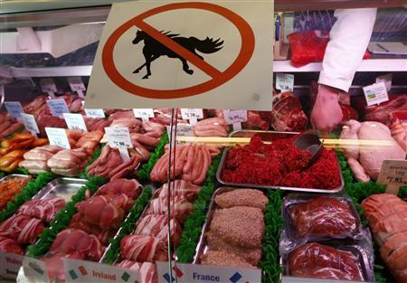 Butcher Sean Basey works behind a ''no horsemeat'' sign at Bates Butchers in Market Harborough, central England, February 20, 2013. REUTERS/Darren Staples