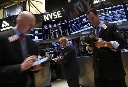 Traders work on the floor of the New York Stock Exchange February 21, 2013. REUTERS/Brendan McDermid