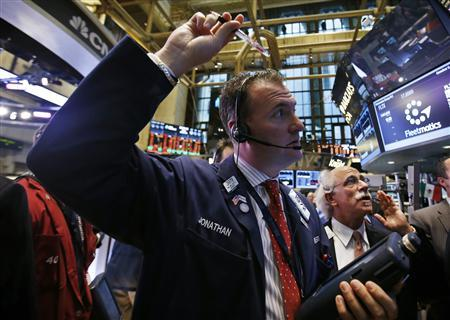 Traders work on the floor of the New York Stock Exchange at the opening of the trading session in New York October 5, 2012. REUTERS/Mike Segar