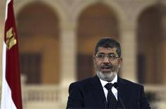 """Egyptian President Mohamed Mursi speaks during a news conference with Turkish President Abdullah Gul (not pictured) after their meeting at Presidential Palace """"Qasr Al Quba"""" in Cairo February 7, 2013. REUTERS/Amr Abdallah Dalsh"""