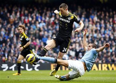 Toure and Tevez strike as City cling to hope