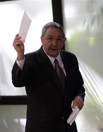 Cuban President Raul Castro shows his voting ballot during the session of the National Assembly of the People's Power in Havana February 24, 2013. REUTERS/Ismael Francisco/Courtesy of Cubadebate/Handout