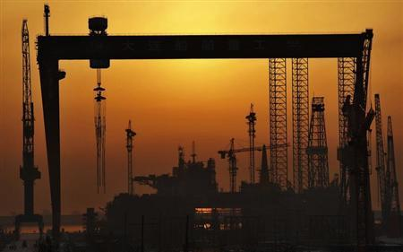 The Dalian Shipbuilding Industry Co.,Ltd working area is seen at sunrise in Dalian, Liaoning province, January 1, 2013. REUTERS/China Daily