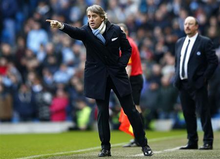 Manchester City's manager Roberto Mancini instructs his team during their English Premier League soccer match against Chelsea at The Etihad Stadium in Manchester, northern England, February 24, 2013. REUTERS/Darren Staples