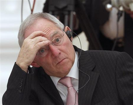 German Finance Minister Wolfgang Schaeuble reacts during a meeting of G20 representatives with Russian President Vladimir Putin in the Kremlin February 15, 2013. REUTERS/Maxim Shemetov (RUSSIA - Tags: POLITICS BUSINESS)