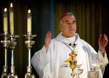 Archbishop of St Andrews and Edinburgh Keith O'Brien gives mass at St Mary's Cathedral in Edinburgh, September 29, 2003. REUTERS/Jeff J Mitchell