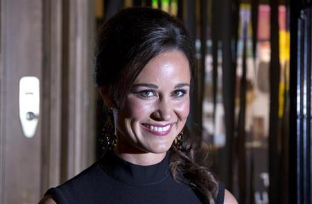 Pippa Middleton, sister of Catherine, Duchess of Cambridge, poses for photographers to promote her first book ''Celebrate'', on the subject of party planning, in London October 25, 2012. REUTERS/Neil Hall