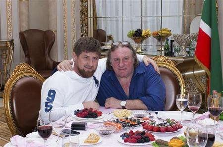 Actor Gerard Depardieu (R) poses for a picture with Chechen President Ramzan Kadyrov during a meeting at the presidential residence as he visits the capital of the Chechen Republic Grozny February 25, 2013. REUTERS/Rasul Yarichev
