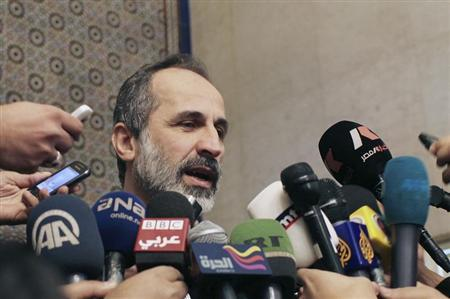 Syrian National Coalition leader Moaz Alkhatib speaks to the media after meeting with Arab League head Nabil al-Arabi in Cairo February 11, 2013. REUTERS/Asmaa Waguih