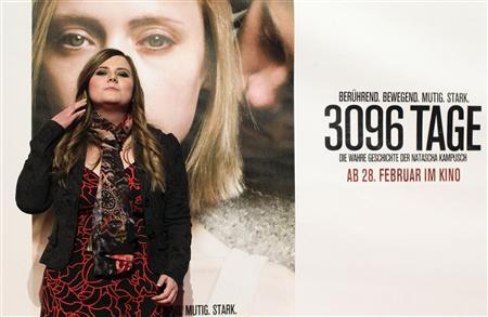 Austrian kidnap victim Natascha Kampusch poses in front of a film poster before the premiere of the film ''3,096 Days'' in a cinema in Vienna February 25, 2013. A new film based on the story of Kampusch shows her being repeatedly raped by captor who beat and starved her during the eight-and-a-half years that he kept her in a cellar beneath his house. REUTERS/Herwig Prammer