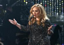 """British singer Adele perfoms the song """"Skyfall"""" from film """"Skyfall,"""" nominated as best orginal song, at the 85th Academy Awards in Hollywood, California February 24, 2013. REUTERS/Mario Anzuoni"""