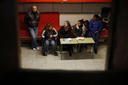 Marcheline Rosero (2nd L), 45, disabled from the effects of polio as a child in Ecuador, meets with a support group at the ''self-managed liberated sociocultural space (EKO),'' a public space for social use, in Madrid February 7, 2013. REUTERS/Juan Medina