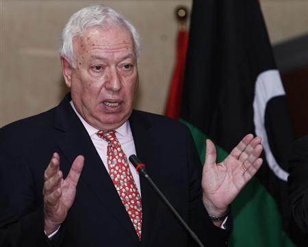 Spain's Foreign Minister Jose Manuel Garcia-Margallo speaks during a news conference at the headquarters of the prime minister's office in Tripoli December 17, 2012. REUTERS/Ismail Zitouny
