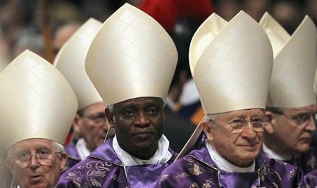 Cardinal Peter Turkson (2nd L) during the Ash Wednesday mass at the Vatican February 13, 2013. REUTERS/Alessandro Bianchi