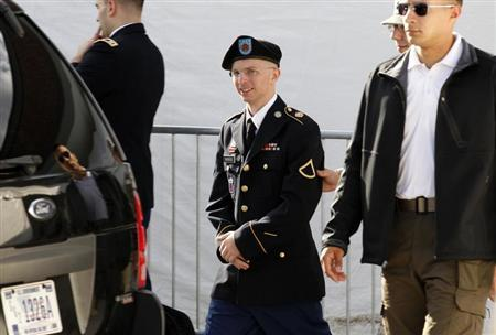 Army Private First Class Bradley Manning (C) is escorted in handcuffs as he leaves the courthouse in Fort Meade, Maryland June 6, 2012. REUTERS/Jose Luis Magana