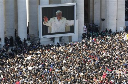 ope Benedict XVI appears on a giant screen in a packed Saint Peter's Square at the Vatican during his last general audience, February 27, 2013. REUTERS/Stefano Rellandin