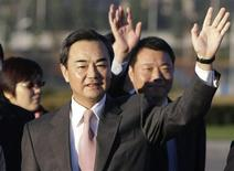 Wang Yi, the director of China's National Taiwan Affairs Office, waves to see Chen Yunlin (not in picture), chairman of China's Association for Relations Across the Taiwan Strait, off Beijing to Taiwan from the Beijing international airport, in this November 3, 2008 file photo. REUTERS/Jason Lee/Files