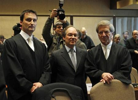 Former representative of Sal. Oppenheim, Christopher Alfred Freiherr von Oppenheim (C) and his lawyers wait for the start of a trial at the regional court in Cologne February 26, 2013. Members of Sal. Oppenheim's former management are accused of misusing bank assets when they were granted loans on favourable conditions. Sal. Oppenheim, a blue-blooded brand which has been serving the ultra rich since 1789, was forced to sell itself to Deutsche Bank for 1 billion euros ($1.3 billion) in 2010. REUTERS/Ina Fassbender (GERMANY - Tags: CRIME LAW) - RTR3ECCY