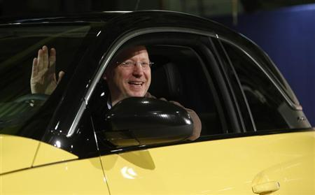 General Motors Vice Chairman, interim President of GM Europe and Chairman of the Opel Supervisory Board Steve Girsky waves as he sits inside an Opel Adam car during the start of the car production in Eisenach January 10, 2013. REUTERS/Lisi Niesner (GERMANY - Tags: BUSINESS TRANSPORT) - RTR3CA17