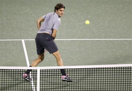 Roger Federer of Switzerland hits a return to Marcel Granollers of Spain during their men's singles match at the ATP Dubai Tennis Championships, February 27, 2013. REUTERS/Ahmed Jadallah