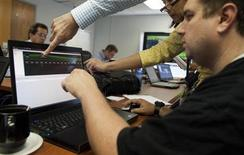 Attacking team members work to hack into a network during a drill at a Department of Homeland Security cyber security defense lab at the Idaho National Laboratory in Idaho Falls, Idaho, September 30, 2011. REUTERS/Jim Urquhart