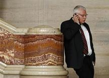 Anti-gay activist William Whatcott talks on his phone during a break in hearings at the Supreme Court of Canada in Ottawa October 12, 2011. REUTERS/Chris Wattie