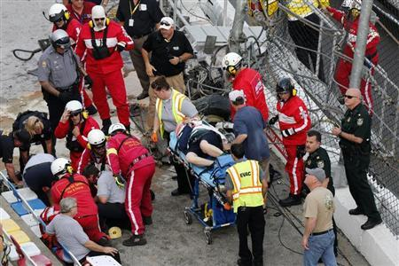 Rescue workers attend to the injured in the stands following a last-lap incident during the NASCAR Nationwide Series DRIVE4COPD 300 race at the Daytona International Speedway in Daytona Beach, Florida February 23, 2013. REUTERS/Pierre Ducharme