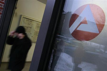 A man leaves a job centre in Berlin January 4, 2011. REUTERS/Thomas Peter