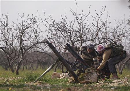 Free Syrian Army fighters set up mortar bombs, pointing towards Nairab military airport and the international airport, which are controlled by forces loyal to Syria's President Bashar al-Assad in Aleppo, February 19, 2013. REUTERS/Muzaffar Salman