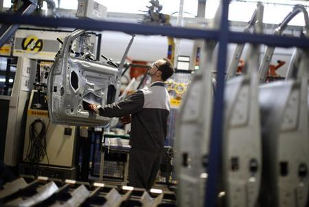 An employee works on Opel car doors at the Opel factory in Eisenach January 10, 2013. REUTERS/Lisi Niesner