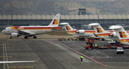 An Iberia passenger plane taxis on the tarmac of Madrid's Barajas airport February 28, 2013. REUTERS/Sergio Perez