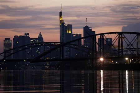 A new bridge is installed over the river Main in front of the Frankfurt skyline August 21, 2012. REUTERS/Alex Domanski (GERMANY - Tags: CITYSPACE SOCIETY)