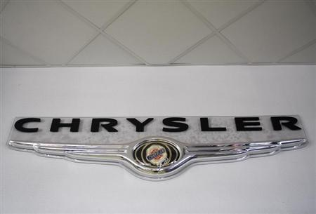 The Chrysler logo hangs on the wall at Performance Chrysler Jeep Dodge dealership in Phoenix, Arizona May 16, 2009. REUTERS/Joshua Lott